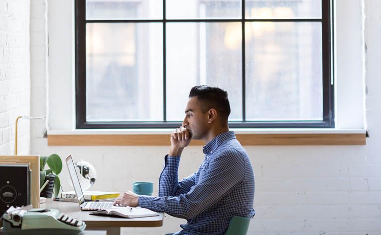Man wearing a blue shirt while working