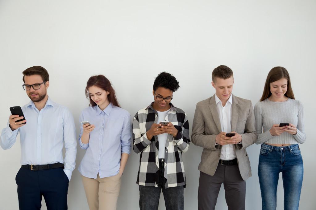 people using their phones