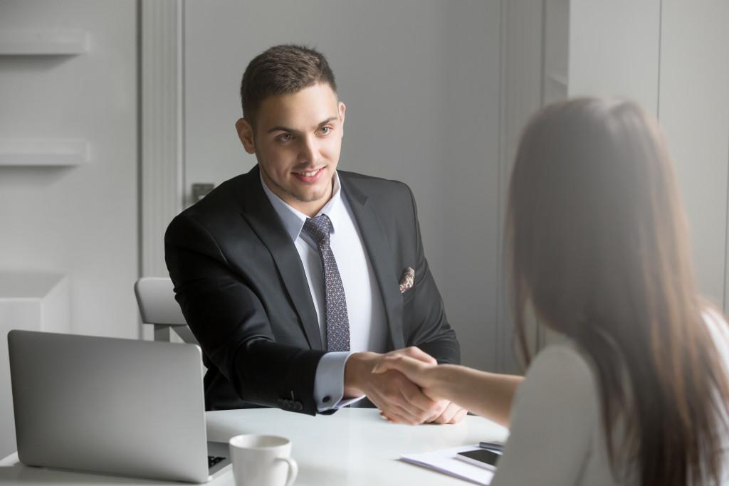 interviewer congratulating an applicant